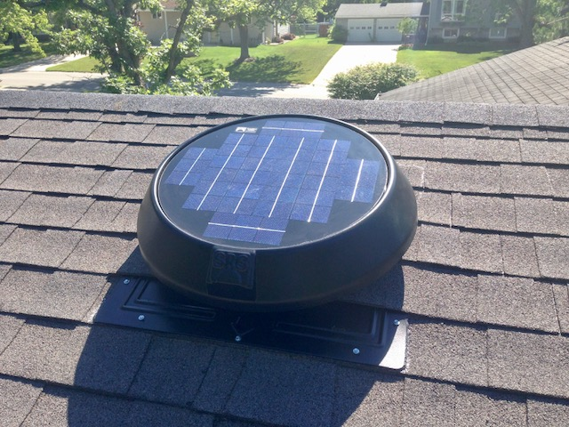 A flat base solar attic fan installed on a client's roof