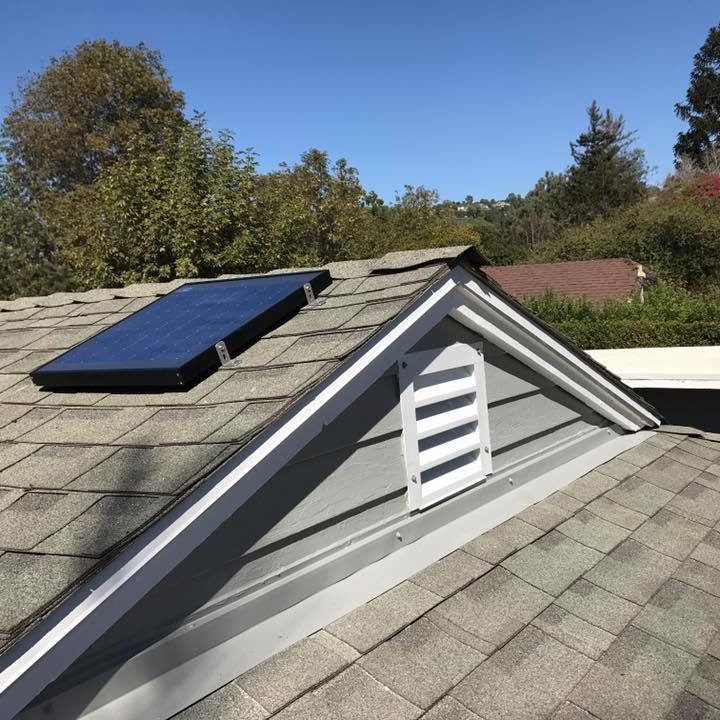 A gable mount solar attic fan installed on a client's roof
